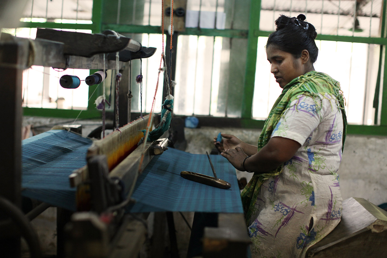 Khurshida Begum weaves fabric for People Tree's Spring collection at Swallows, Bangladesh