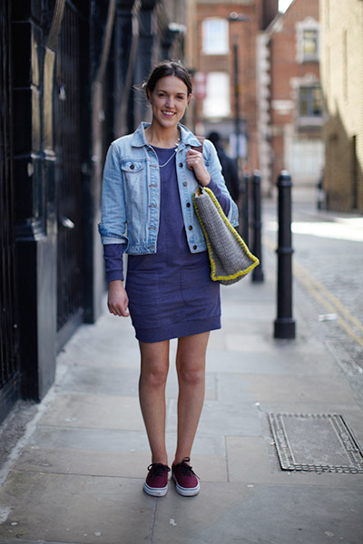Ruby pairs a blue Nina Dress with a pop of neon yellow in the Jute Bag