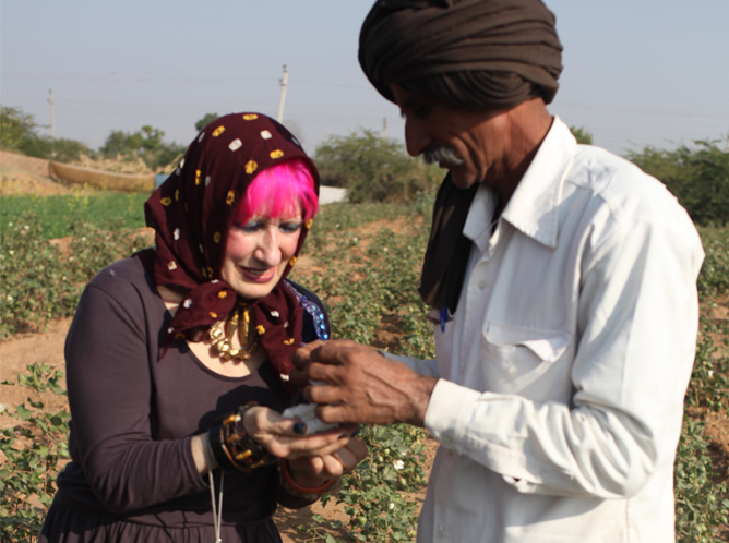 Zandra meets one of the organic cotton farmers who grew the cotton for her collection