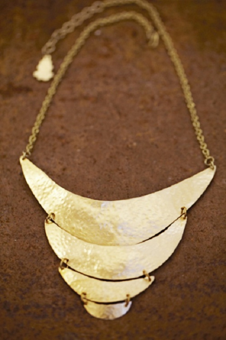Stunning statement necklace crafted from four crescents of hand beaten brass, delicately linked together on an elegant hand made chain.