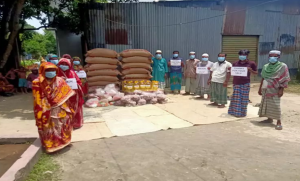 Staff at DevTech preparing to distribute food to their community during the covid pandemic